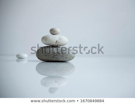 Balance zen stones in clear background Stock photo © cienpies