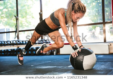 portrait of fitness disabled sportswoman in tracksuit doing cros stock photo © deandrobot