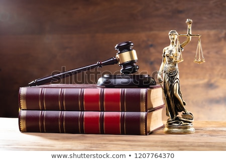 Lady Justice Near Gavel Over Law Book Stock photo © AndreyPopov