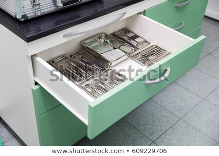 Dental utensils in the drawer Stock photo © boggy