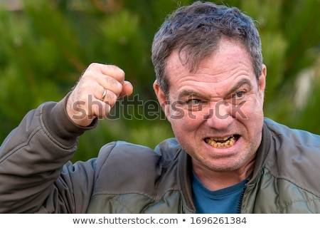 angry young man threatening to fight with his fists  Stock photo © feedough