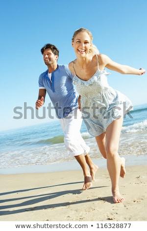 を実行して · カップル · ジョギング · 行使 · ビーチ · 話し - ストックフォト © dolgachov