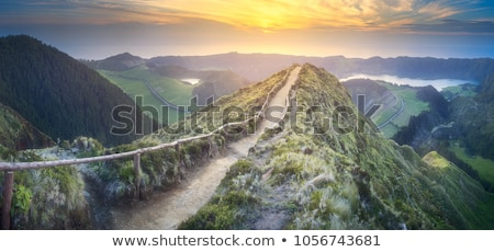 Mountain landscape with peak in clouds and hut Stock photo © Kotenko