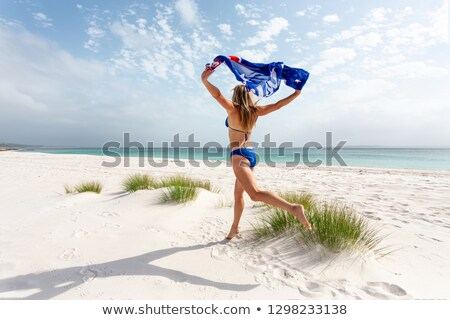 Woman running and leaping with Australian Flag Stock photo © lovleah
