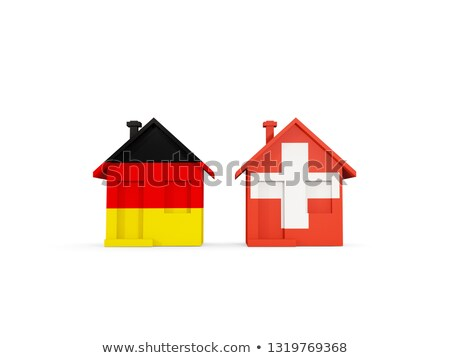 Two houses with flags of Germany and switzerland Stock photo © MikhailMishchenko