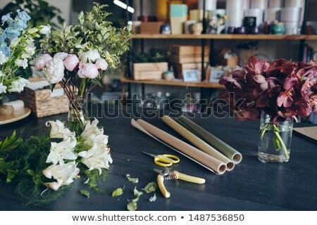 Close-up of flowers in vases, secateurs, scissors Stock photo © pressmaster