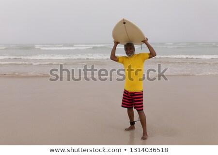 Elöl kilátás boldog idős férfi szörfös Stock fotó © wavebreak_media