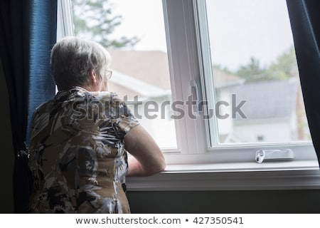 lonely 60 years old senior in is apartment Stock photo © Lopolo