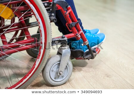 Rear view of young disabled Caucasian woman sitting on wheelchair facing the sea at beach. She is lo Stock photo © wavebreak_media