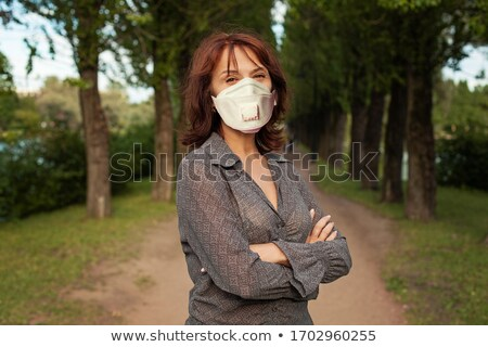 Happy older woman in medical mask outdoors Stock photo © dashapetrenko