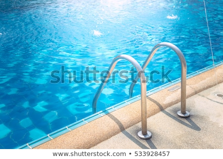 Grab bars ladder in the swimming pool Stock photo © cookelma