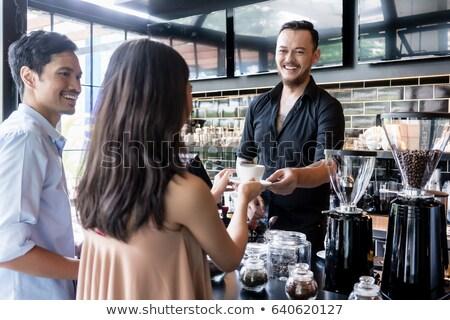 Barista Serves Woman, Interior of Coffeehouse Stock photo © robuart