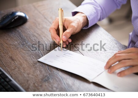 Boss Holding Payroll Bank Check Stock photo © AndreyPopov