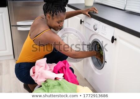 Woman Washing Clothes Using Washer Machine Stock photo © AndreyPopov