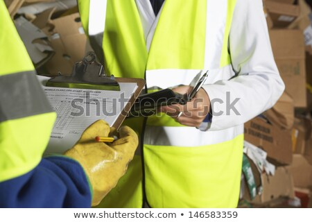 Young worker in a fluorescent jacket Stock photo © photography33