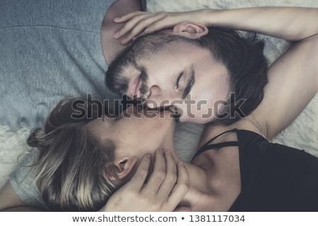 romantikus · szerelmespár · átkarol · ágy · otthon · szeretet - stock fotó © photography33
