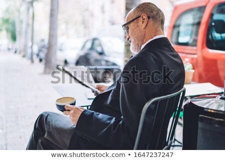 Man with newspaper and coffee Stock photo © photography33