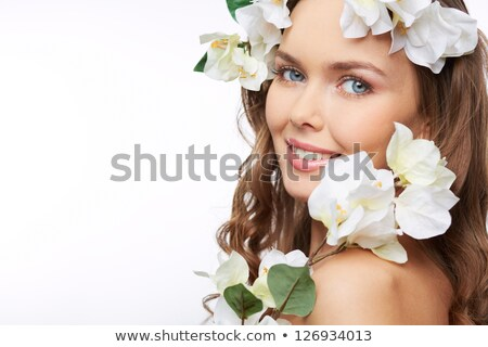 young charming woman with flowers in her hair stock photo © feedough