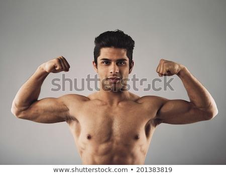 Bodybuilder showing off his biceps Stock photo © stryjek
