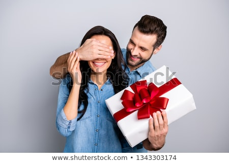 Man surprising wife with gift Stock photo © photography33