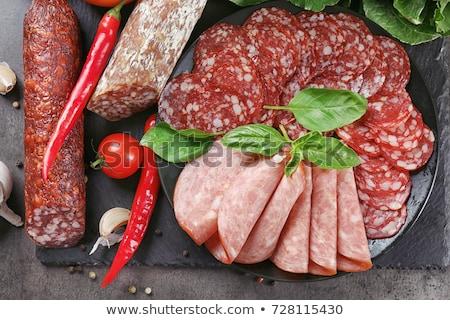 Különböző szeletel kolbászok zöldségek közelkép étel Stock fotó © shutswis