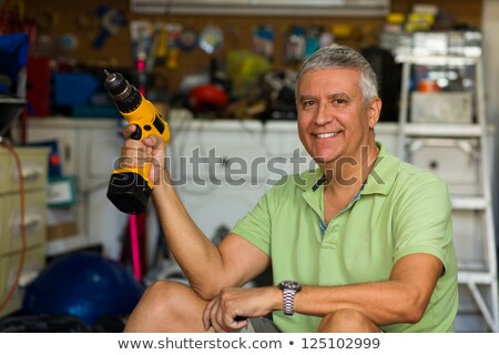 Grey-haired man holding screw-driver Stock photo © photography33