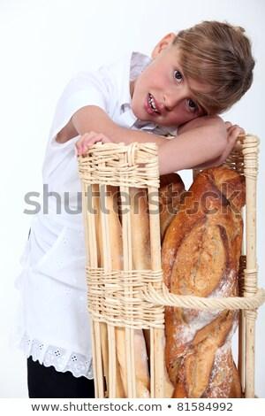 little girl dressed in baker reposing on a bread bin Stock photo © photography33