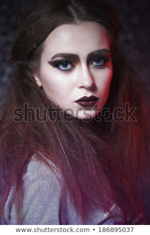 beauty girl looking sideways  with full color make up Stock photo © carlodapino