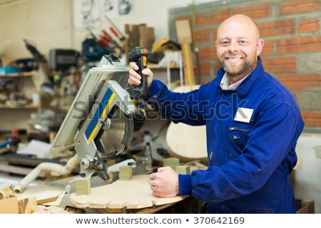 Woodworker holding a sander Stock photo © photography33