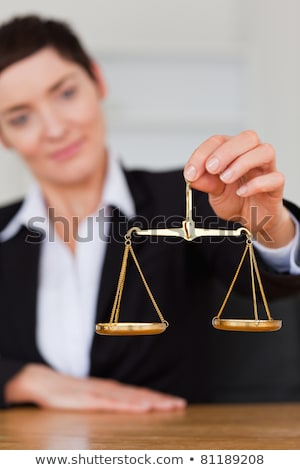 portrait of a businesswoman holding the justice scale in her office stock photo © wavebreak_media
