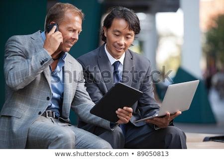 sorridente · asiático · empresário · comprimido · escritório · feliz - foto stock © szefei