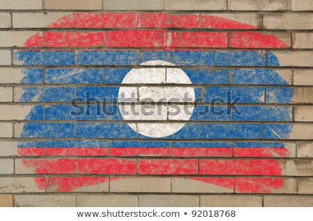 Flag Of Laos On Grunge Brick Wall Painted With Chalk Foto stock © vepar5