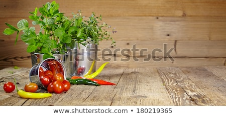 Fresh chive on wooden table Stock photo © Kesu