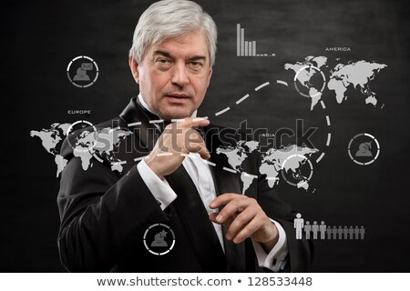 Sólido homem de negócios trabalhando virtual interface edifício Foto stock © HASLOO