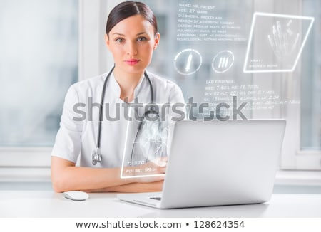 Doctor with hightech computer screen viewing patient data Stock photo © HASLOO