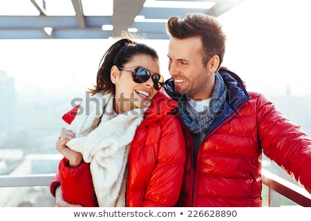 Couple In Winter Jackets Embracing Stock photo © unkreatives