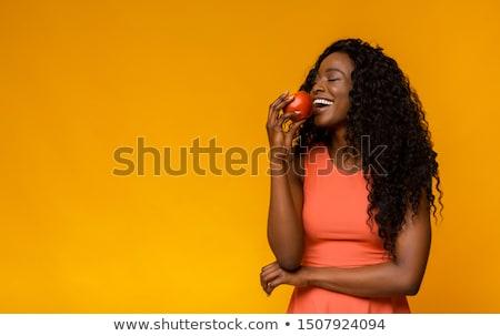 Mulher comer maçã vermelha mão Foto stock © maros_b