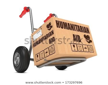 Social Aid - Cardboard Box on Hand Truck. Stock photo © tashatuvango