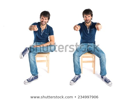 bearded man sits and looks at you stock photo © feedough