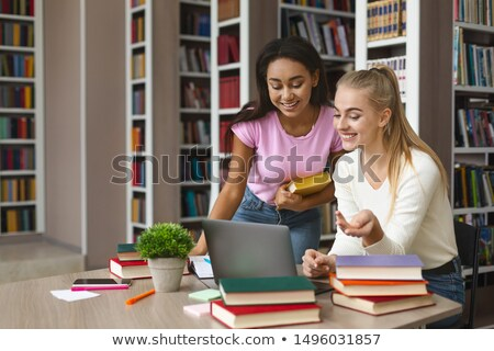 teenage girl copying classmate's assignment Stock photo © ambro