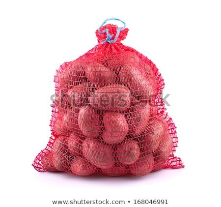 potatos in red string bag stock photo © boroda