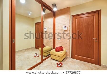 Wooden door of wardrobe with warm light Stock photo © punsayaporn