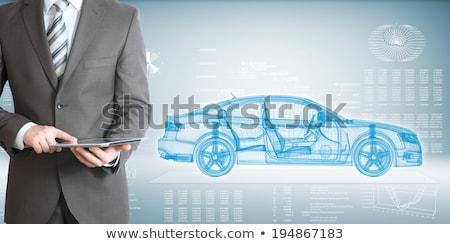 Businessman with wire frame car Stock photo © cherezoff