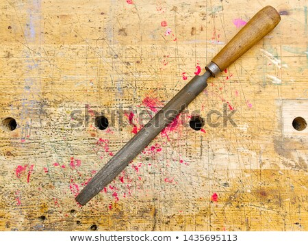 old wood rasp with red handle stock photo © taigi