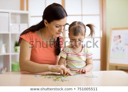 Fűrész egymásra pakolva együtt boglya kirakós játék darabok Stock fotó © dezign56