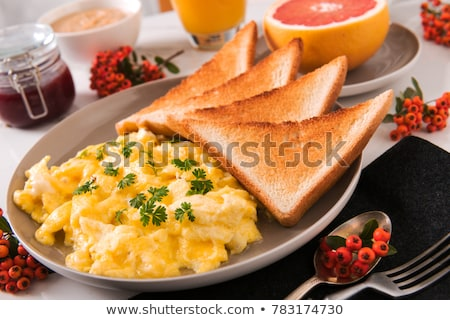 Scrambled eggs and toast Stock photo © Digifoodstock