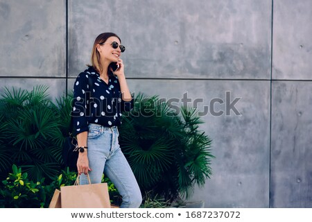 happy girl with shopping bags having a phone call stock photo © milanmarkovic78