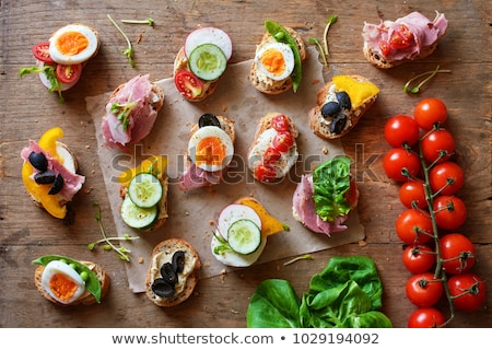 Canape with ham, tomato and cucumber on the bar Stock photo © d_duda
