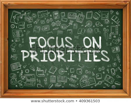 Focus on Priorities - Green Chalkboard. Stock photo © tashatuvango