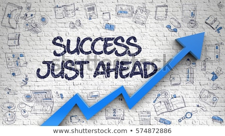 Success Just Ahead on White Brick Wall. Stock photo © tashatuvango